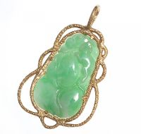 CARVED JADE PENDANT IN AN 18 CT GOLD MOUNT by Jade at Ross's Auctions