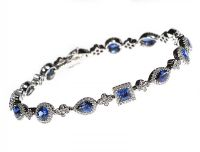 18CT WHITE GOLD SAPPHIRE AND DIAMOND CLUSTER BRACELET at Ross's Auctions