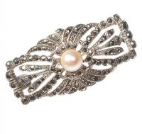 SILVER PIERCED BROOCH SET WITH MARCASITE AND A CULTURED PEARL at Ross's Auctions