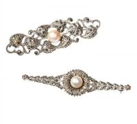 A PAIR OF SILVER PIERCED FLORAL BAR BROOCHES SET WITH MARCASITE AND CULTURED PEARLS at Ross's Auctions
