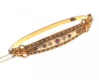 9CT GOLD ANTIQUE EDWARDIAN DIAMOND AND GARNET BANGLE at Ross's Auctions