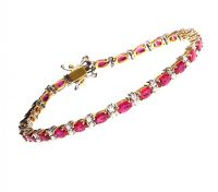 18CT GOLD RUBY AND DIAMOND BRACELET at Ross's Auctions