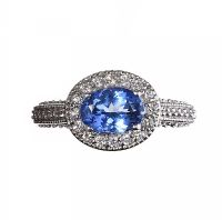 18CT WHITE GOLD TANZANITE AND DIAMOND CLUSTER RING at Ross's Auctions