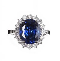 18CT WHITE GOLD SAPPHIRE AND DIAMOND CLUSTER RING at Ross's Auctions
