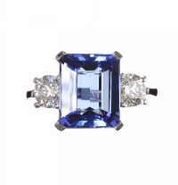 18CT WHITE GOLD TANZANITE AND DIAMOND THREE STONE RING at Ross's Auctions