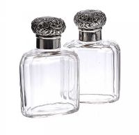 PAIR OF MAPPIN AND WEBB SILVER TOPPED COLOGNE BOTTLES