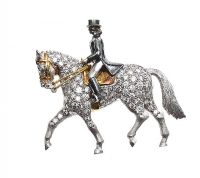 18CT WHITE GOLD 'HORSE AND RIDER' BROOCH SET WITH DIAMONDS