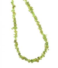 STRAND OF TUMBLED PERIDOT BEADS at Ross's Jewellery Auctions