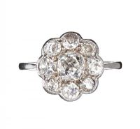 PLATINUM AND DIAMOND ANTIQUE DAISY CLUSTER RING at Ross's Auctions