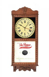 AMERICAN ADVERTISING OAK WALL CLOCK at Ross's Auctions