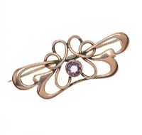 ART NOUVEAU 9CT ROSE GOLD BROOCH SET WITH AMETHYST at Ross's Jewellery Auctions