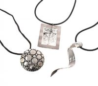 THREE STERLING SILVER PENDANTS ON CORD, ONE WITH RUTILATED QUARTZ at Ross's Jewellery Auctions