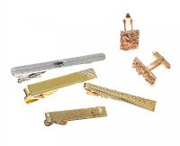 FOUR TIE CLIPS AND A PAIR OF CUFFLINKS at Ross's Jewellery Auctions