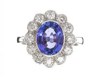 18CT WHITE GOLD TANZANITE AND DIAMOND CLUSTER RING at Ross's Jewellery Auctions
