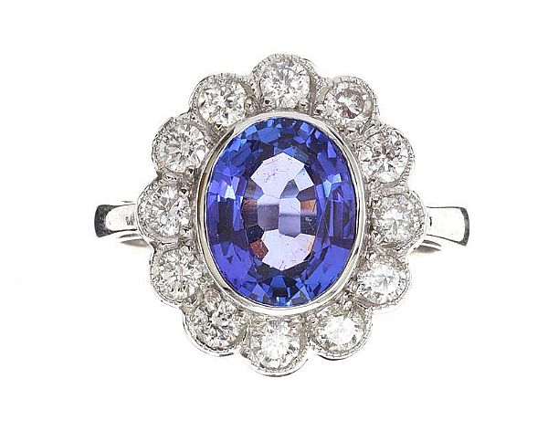 18CT WHITE GOLD TANZANITE AND DIAMOND CLUSTER RING at Ross's Online Art Auctions