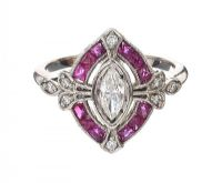 PLATINUM RUBY AND DIAMOND CALIBRE RING at Ross's Auctions