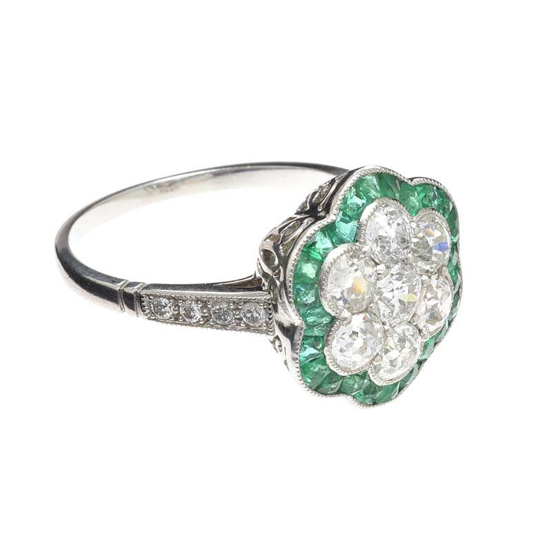 PLATINUM EMERALD AND DIAMOND CLUSTER RING at Ross's Online Art Auctions