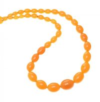 GRADUATED STRAND OF BALTIC BUTTERSCOTCH AMBER BEADS at Ross's Jewellery Auctions